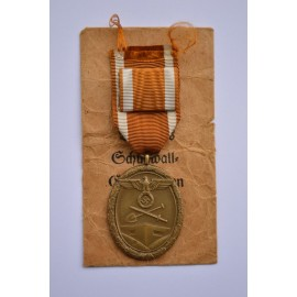 A West Wall Campaign Medal with enwelope maker Sohni, Heubach & Co Oberstein.