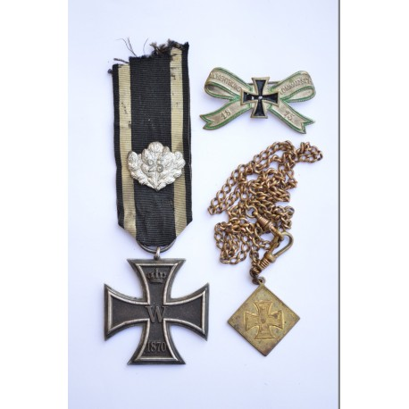"""An 1870 Iron Cross II Class, with """"25"""" Jubilee Oak Leaves with a veteran badge 1875 and a memorial from service 1870."""