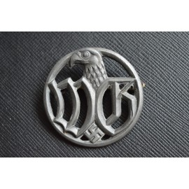 A Wehrmacht Entourage Badge by C.E Junker.