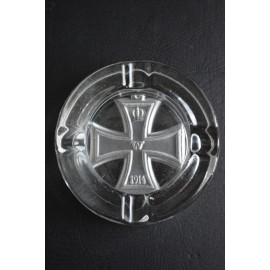 A 100 year old glass ashtray embossed with the Iron Cross.