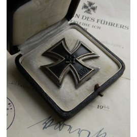Iron Cross First Class 1939 unmarked with box and paper award.