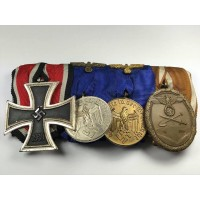 Four Medals Bar WWII with Iron Cross second class maker Otto Schickle one piece, very rare cross.