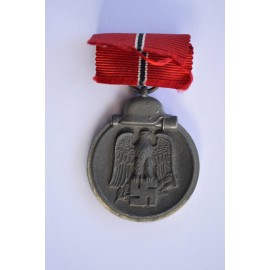 A 1941 - 42 EAST MEDAL MARKED 7 BY maker Paul Meybauer, Berlin.