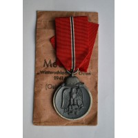 A 1941 - 42 EAST MEDAL MARKED 19 maker E. Ferdinand Wiedmann, Frankfurt am Main with enwelope.