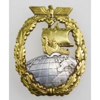 A Mint Auxiliary Cruiser War Badge by SCHWERIN.