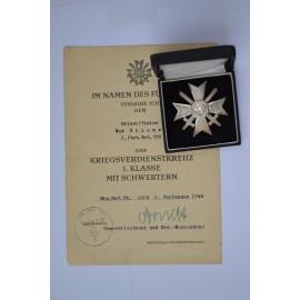 A War Merit Cross First Class with Swords in case marked 1 maker Deschler & Sohn and Paper Award signed Generalleutnant.