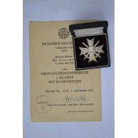 A War Merit Cross First Class with Swords marked 1 maker Deschler & Sohn and Paper Award signed Generalleutnant.