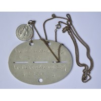 A Second War German ID DISC - LN. FU. RS. KP. (MOT) 18/7 with a chain and a medallion