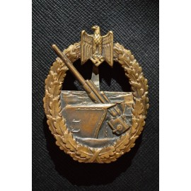 A Coastal Artillery badge by C.E. Juncker.