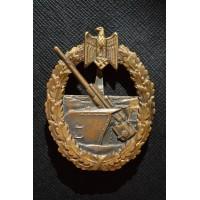 A Coastal Artillery badge by C.E. Juncker.