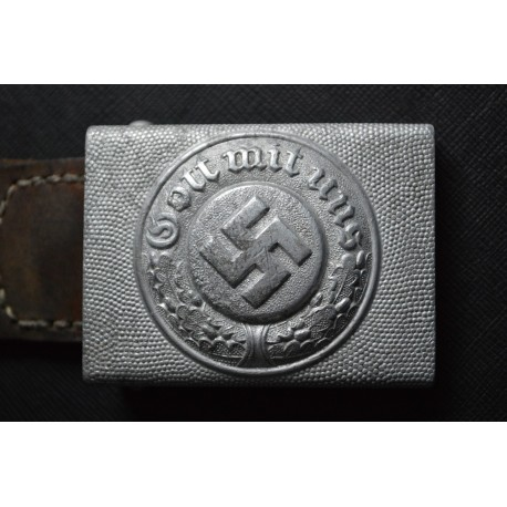 A German Police Buckle marked J.F.S. with Leather Tab.