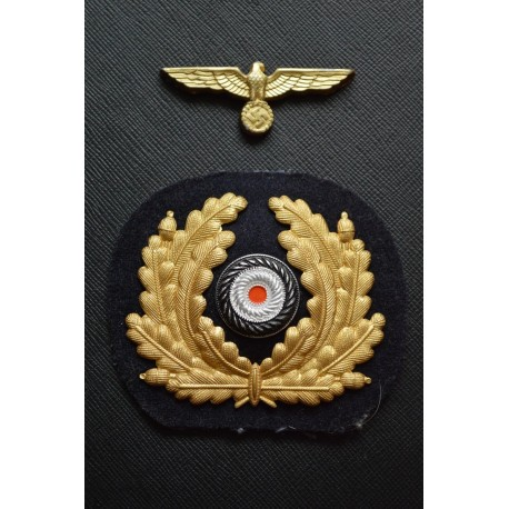 Set Eagle and visor wreath marked M 38 and S &S 36, cap insignia.